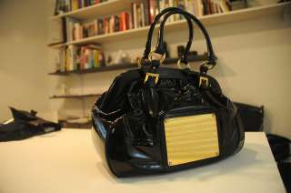 Dolce Gabbana Black Patent leather hand bag with gold badge/accents